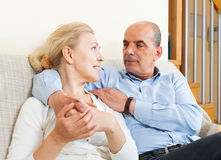 Happy elderly man flirting with mature wife and hug Royalty Free Stock Image