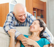 Happy elderly man flirting with mature woman Stock Photo