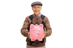 Happy elderly man giving a piggybank. Isolated on white background Stock Photography
