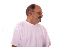 Happy elderly man with Hearing aids. Royalty Free Stock Images