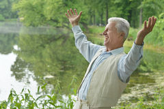 Happy elderly man outdoors Royalty Free Stock Images