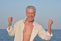 Happy elderly man at sea Royalty Free Stock Image
