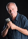 Happy elderly man showing dollars Royalty Free Stock Photo