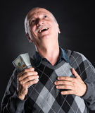 Happy elderly man showing dollars Stock Photo