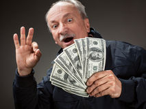 Happy elderly man showing fan of money Royalty Free Stock Photo