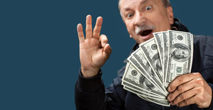 Happy elderly man showing fan of money Royalty Free Stock Photography