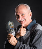 Happy elderly man showing  money and OK sign Royalty Free Stock Photos
