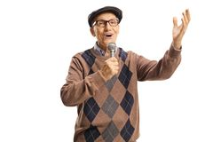 Happy elderly man singing on a microphone and gesturing with hand. Isolated on white background royalty free stock photography