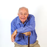Happy elderly man sitting in a chair Stock Photo