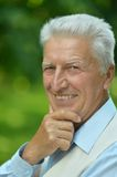 Happy elderly man in summer park Royalty Free Stock Photography