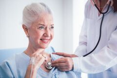 Free Happy Elderly Patient Talk With Woman Doctor At Room In Hospital. Doctor Use Stethoscope Listening Lung Of Elderly Patient. Royalty Free Stock Photo - 191904445
