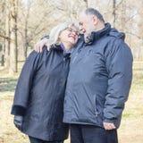 Happy Elderly Senior Couple Embracing Royalty Free Stock Photos
