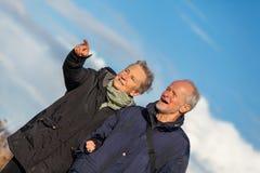 Happy elderly senior couple walking on beach Royalty Free Stock Photo