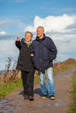 Happy elderly senior couple walking on beach Royalty Free Stock Image