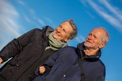 Happy elderly senior couple walking on beach Royalty Free Stock Photography