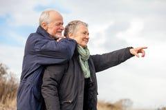 Happy elderly senior couple walking on beach Royalty Free Stock Image