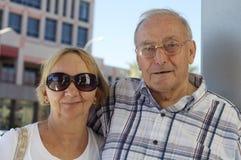 Happy elderly seniors couple in park royalty free stock photo