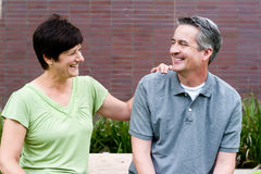 Happy elderly seniors couple in park Stock Photography