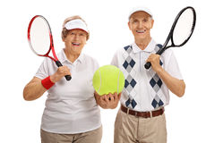 Happy elderly tennis players holding a big tennis ball Stock Image