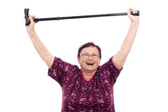 Happy elderly woman. Happy laughing elderly woman holding walking stick, isolated on white background royalty free stock photo