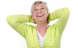 Happy elderly woman with arms up Stock Image