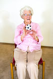 Happy elderly woman catching a ball Stock Photos