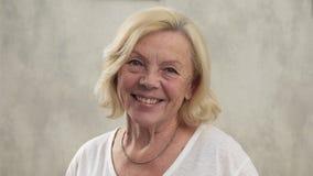 Happy elderly woman stock video