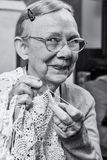 Happy Elderly Woman with Crochet Stock Photos