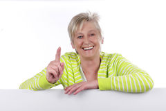 Happy elderly woman in front of white Background Royalty Free Stock Images