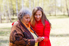 Happy elderly woman with her daughter Royalty Free Stock Photos