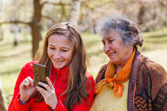 Happy elderly woman with her daughter Stock Photography