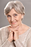Happy elderly woman Stock Photos