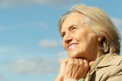 Happy elderly woman posing Stock Photos
