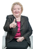 Happy elderly woman showing thumbs up Royalty Free Stock Image