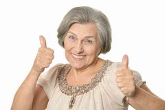 Happy elderly woman. Showing thymbs up isolated on white background Royalty Free Stock Photography