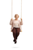 Happy elderly woman on a swing Royalty Free Stock Photography