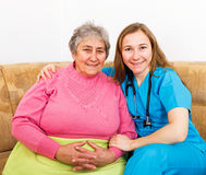 Happy elderly woman and young caregiver Royalty Free Stock Image