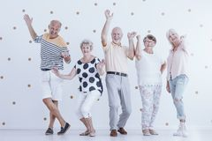 Elders having fun. Happy elders having some fun at a New Year`s Eve party Royalty Free Stock Photo