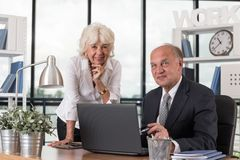 Happy elders in the office. Photo of happy smiling elders in the office Stock Photos