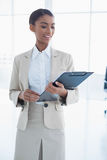 Happy elegant businesswoman holding clipboard Stock Photography