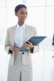 Happy elegant businesswoman holding clipboard Stock Photography