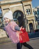 Happy elegant girl in Milan, Italy having fun time Stock Photo