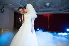 Happy elegant gorgeous married couple performing first dance wit Royalty Free Stock Image