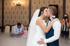 Happy elegant gorgeous married couple performing first dance wit Royalty Free Stock Photos