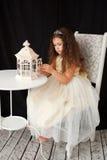 Happy elegant little girl with vintage flashlight Stock Photo