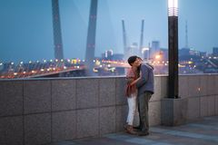Happy elegant middle aged couple smiling and hugging with bokeh backgrond. Stock Photography