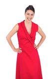 Happy elegant model in red dress posing Stock Photography