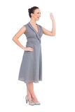 Happy elegant woman in classy dress waving Royalty Free Stock Photo