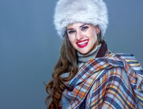 Happy elegant woman in fur hat isolated on cold blue. Winter things. happy elegant woman in fur hat isolated on cold blue Royalty Free Stock Photos