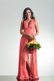 Happy elegant woman in red dress holding a flower basket Royalty Free Stock Photo